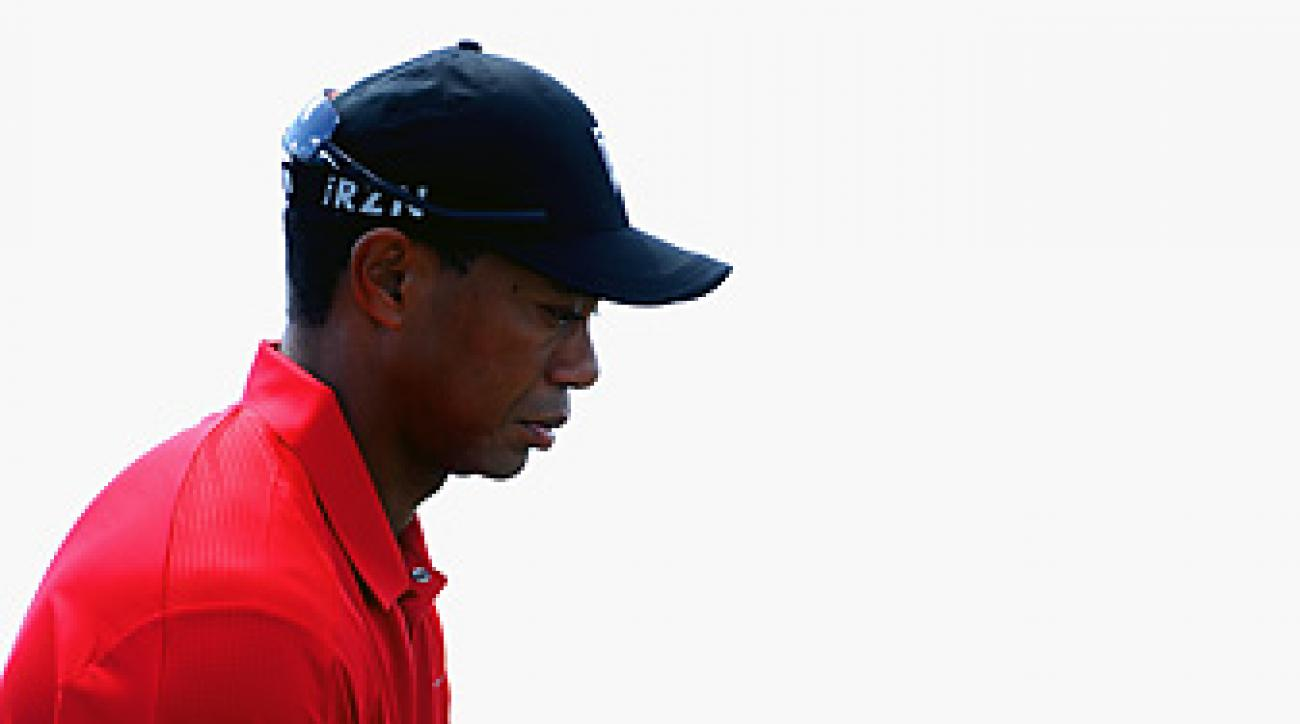 Tiger Woods was 5 over par and 12 shots back when he withdrew from play on No. 13.