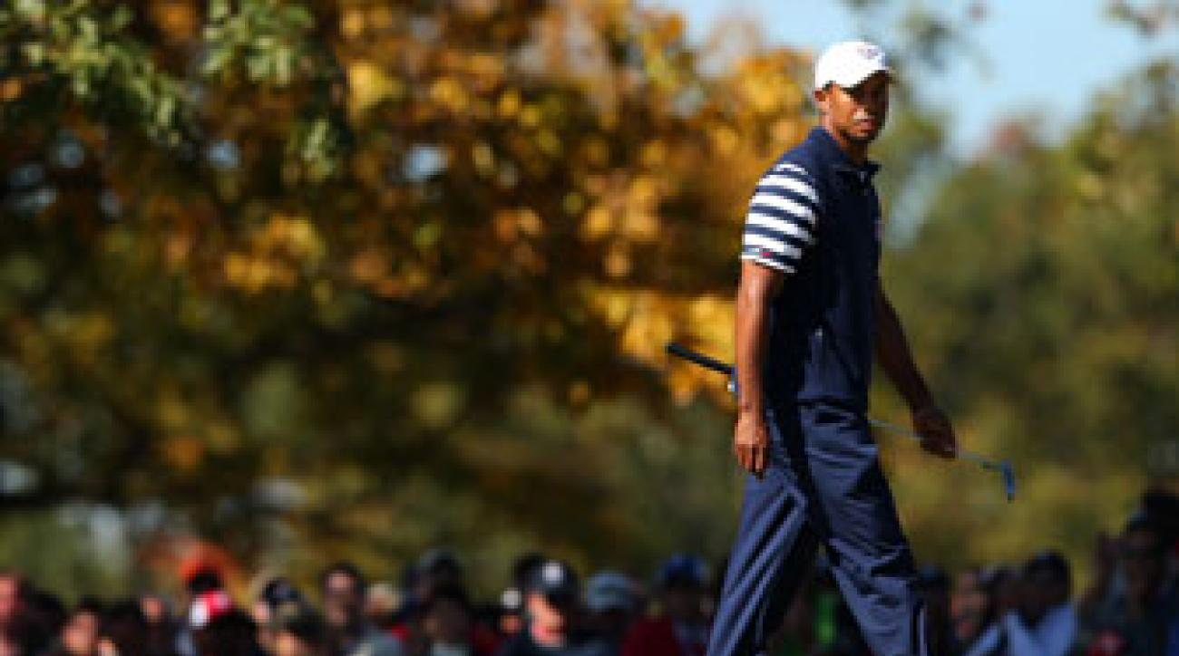 Tiger Woods waits on the fourth green during the singles matches for the 39th Ryder Cup at Medinah Country Club on September 30, 2012.