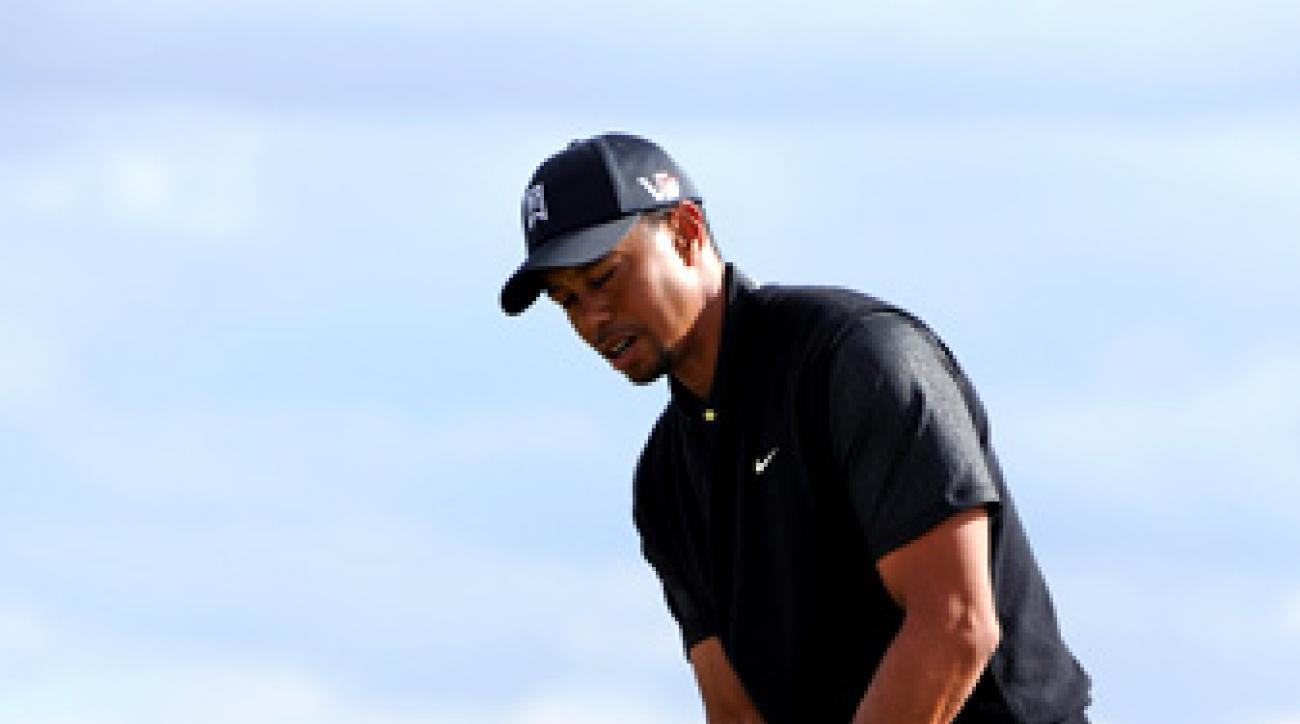 Tiger Woods misses a putt on the eighth hole during his match with Charles Howell III in the first round of the World Match Play Championship at Dove Mountain in Marana, Ariz.