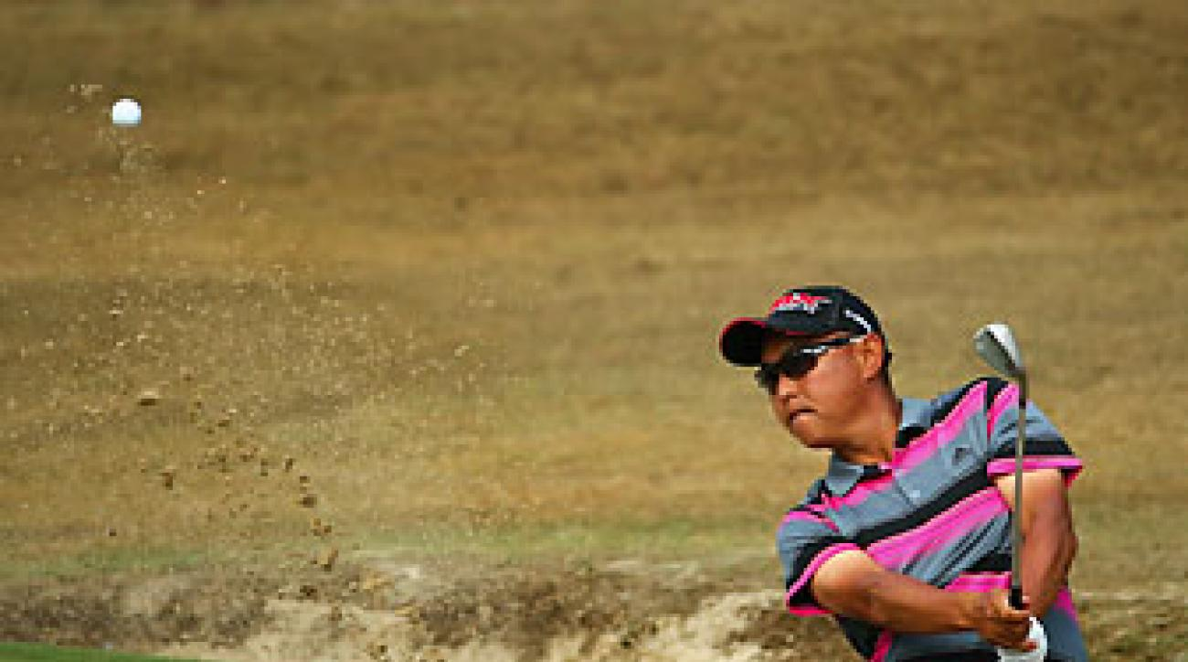 Toru Taniguchi of Japan hits a bunker shot on the fourth hole during the second round of the U.S. Open.
