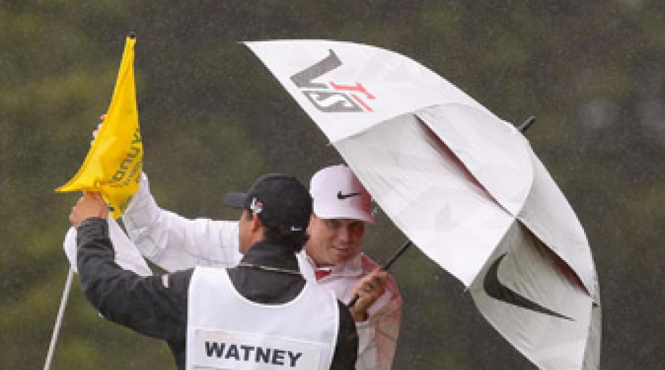Nick Watney and his caddie took shelter from the rain.