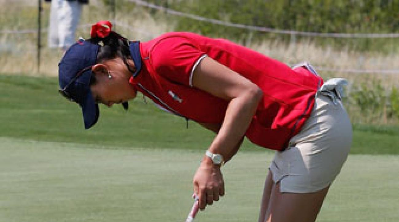 Michelle Wie works on her unique putting stroke during a practice round at the Solheim Cup.