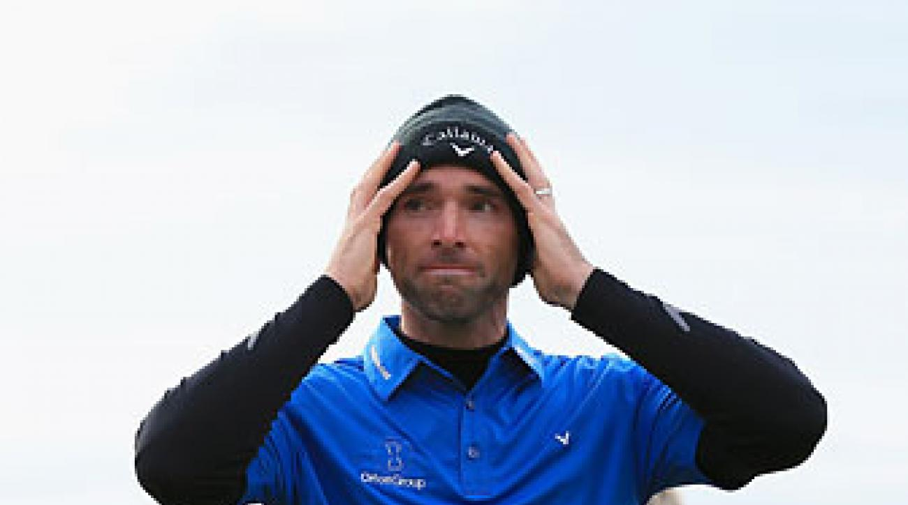 Oliver Wilson looks relieved on the 18th green at St. Andrews after winning the Dunhill Links Championship on Sunday.