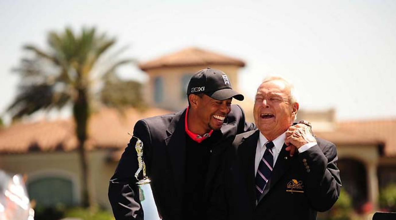 Tiger Woods and Arnold Palmer share a hearty laugh after Woods won the Arnold Palmer Championship at Bay Hill.