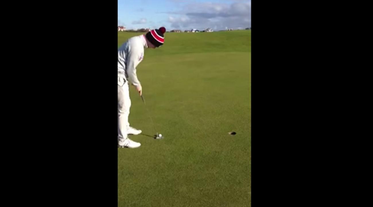 A golfer has some fun with an unconventional three-foot putt.
