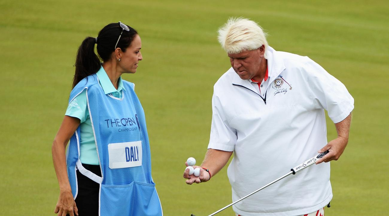 John Daly talks with his girlfriend/caddie Anna Cladakis during a practice round prior to the start of the 2014 Open Championship.