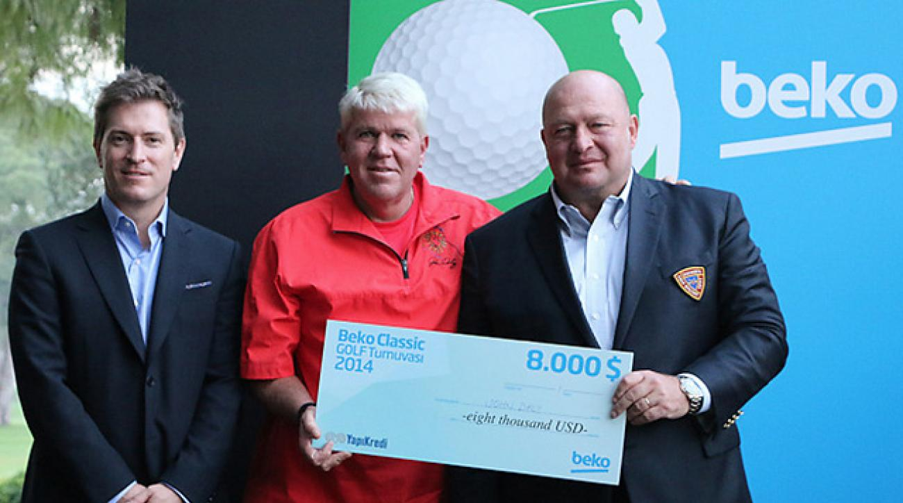 John Daly hoists his giant $8,000 after winning the Beko Classic pro-am event in Turkey.