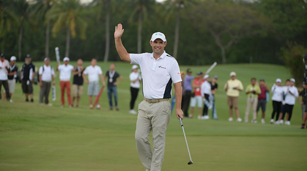 Padraig Harrington waves to the gallery on the 18th green during round four of the Indonesia Open.