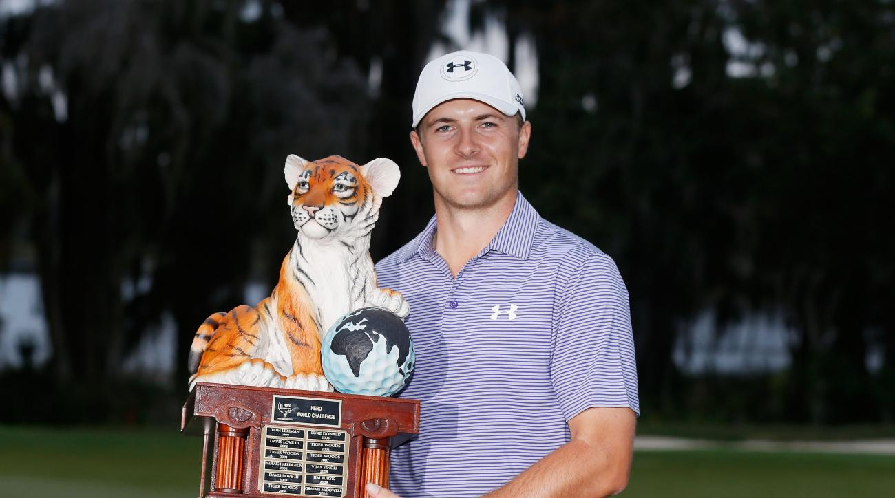 Jordan Spieth poses with the winner's trophy after his ten-stroke victory at the Hero World Challenge.