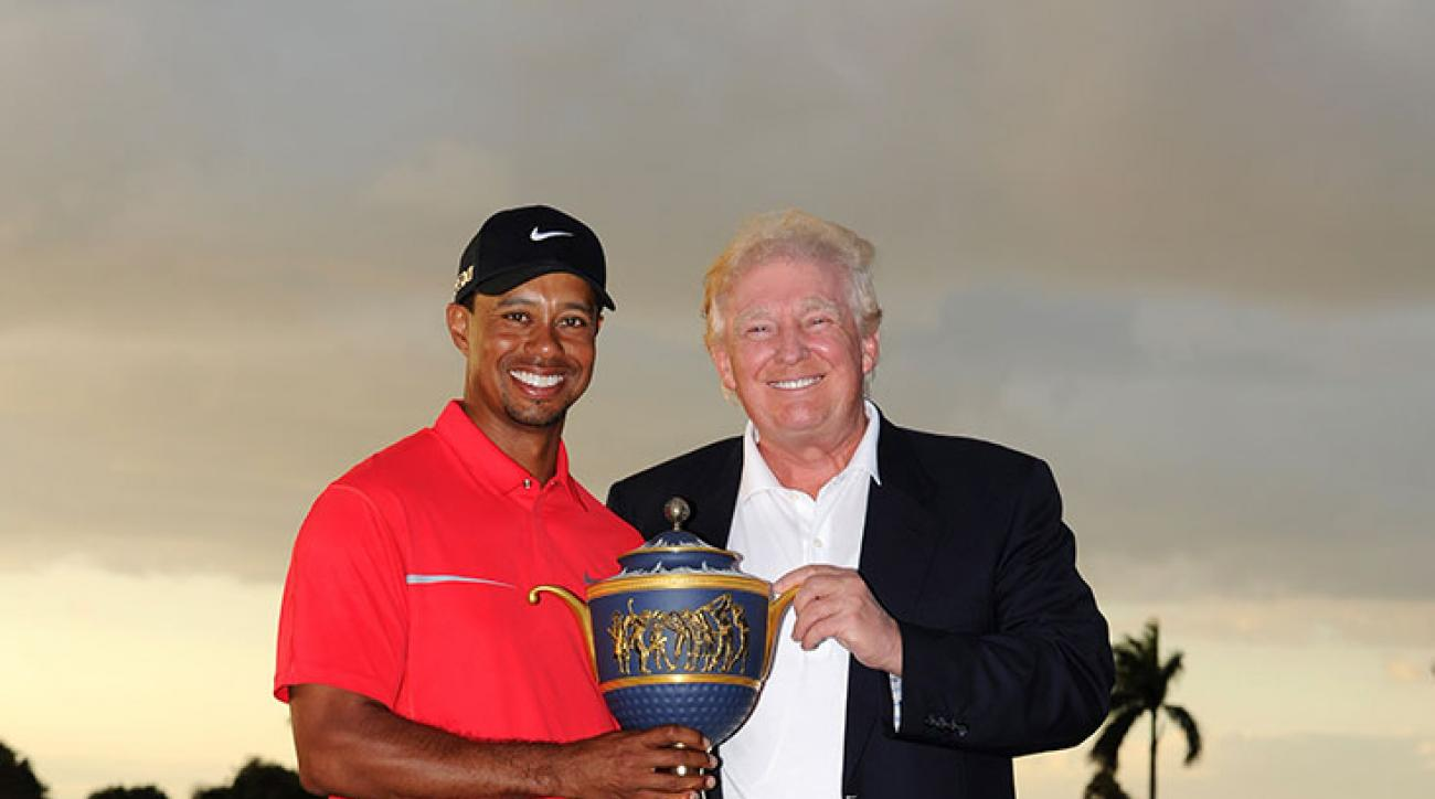 Tiger Woods poses with Donald Trump following his two-stroke victory at the 2013 WGC-Cadillac Championship at Doral.