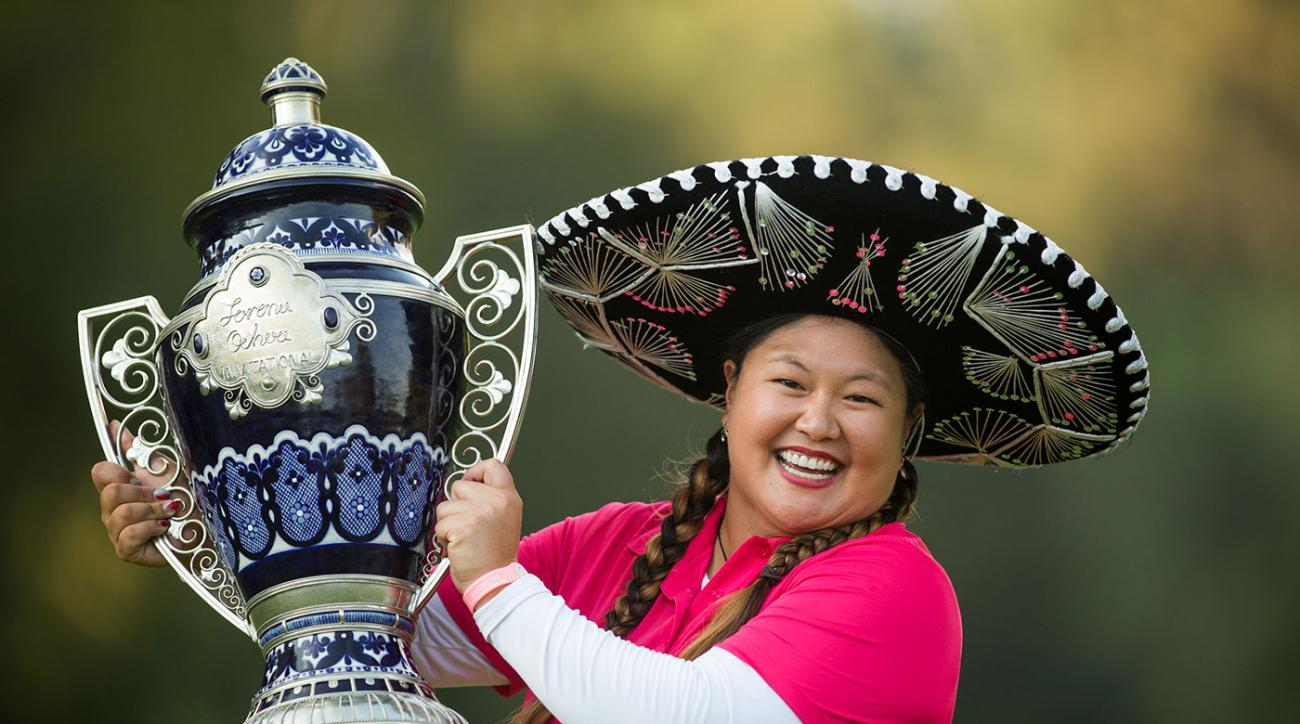 Christina Kim hoists the trophy after her playoff victory at the 2014 Lorena Ochoa Invitational.