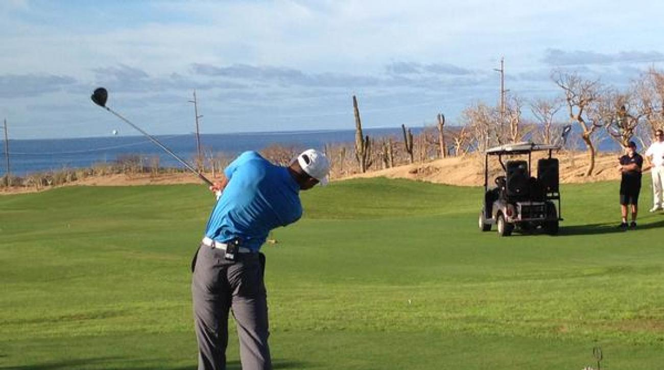 Tiger Woods hits the opening tee shot at El Cardonal at Diamante Cabo San Lucas in Mexico on Tuesday, Dec. 16.