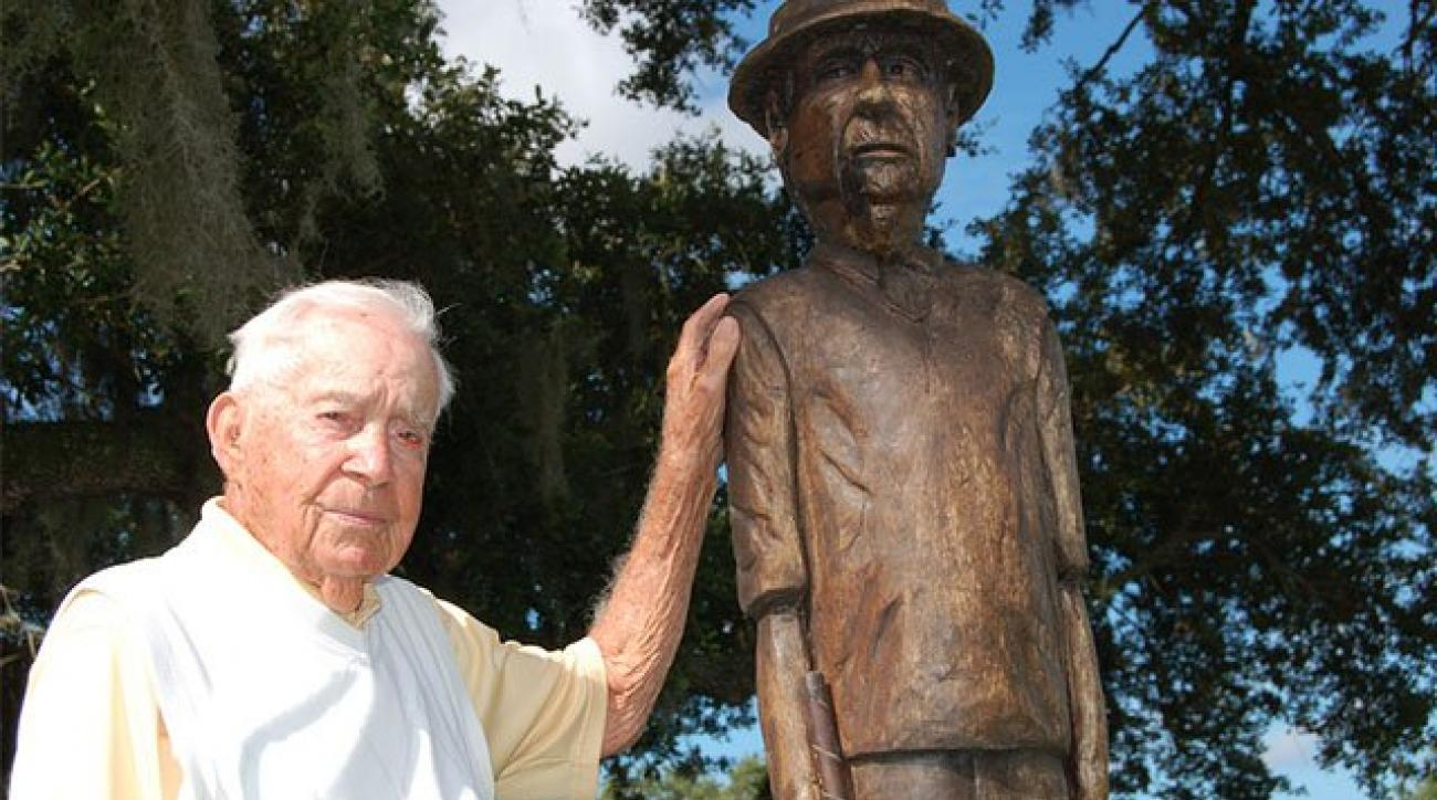 Gus Andreone with his own statue at Gus Andreone Practice and Teaching Facility at the Palm Aire Country Club in Sarasota, Fla.
