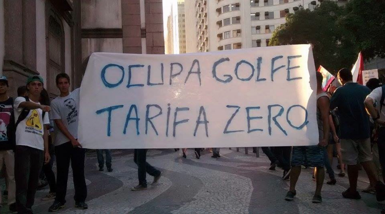 "A group of protestors hold a sign reading, ""Occupy golf, zero tax."""