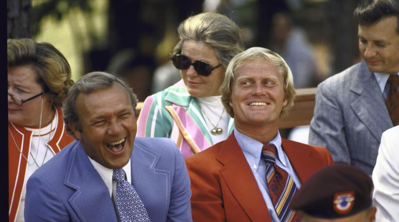 Arnold Palmer and Jack Nicklaus share a laugh at the dedication ceremony for the World Golf Hall of Fame in 1974.
