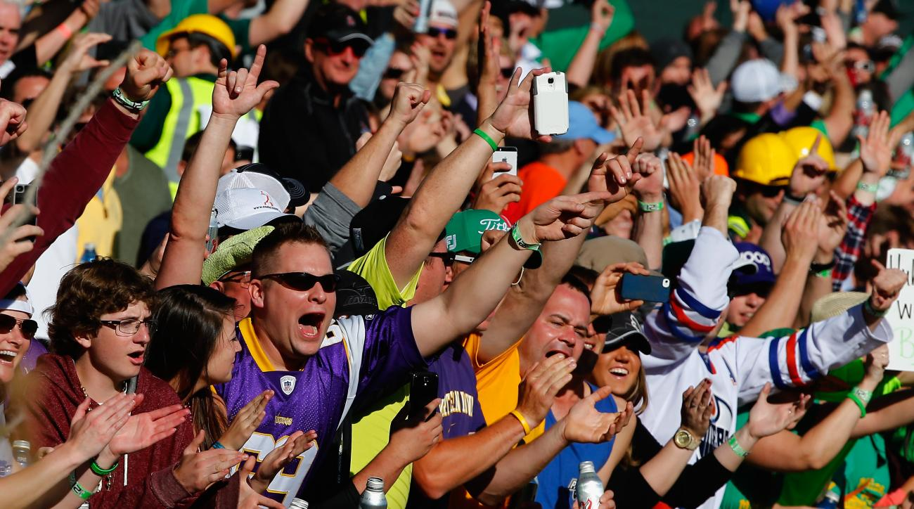 Rowdy fans pack the galleries at the 2014 Phoenix Open.