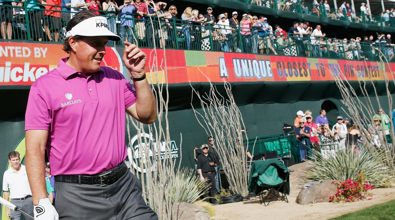 Phil Mickelson walks onto the 16th hole during the pro-am Wednesday at the Waste Management Phoenix Open.