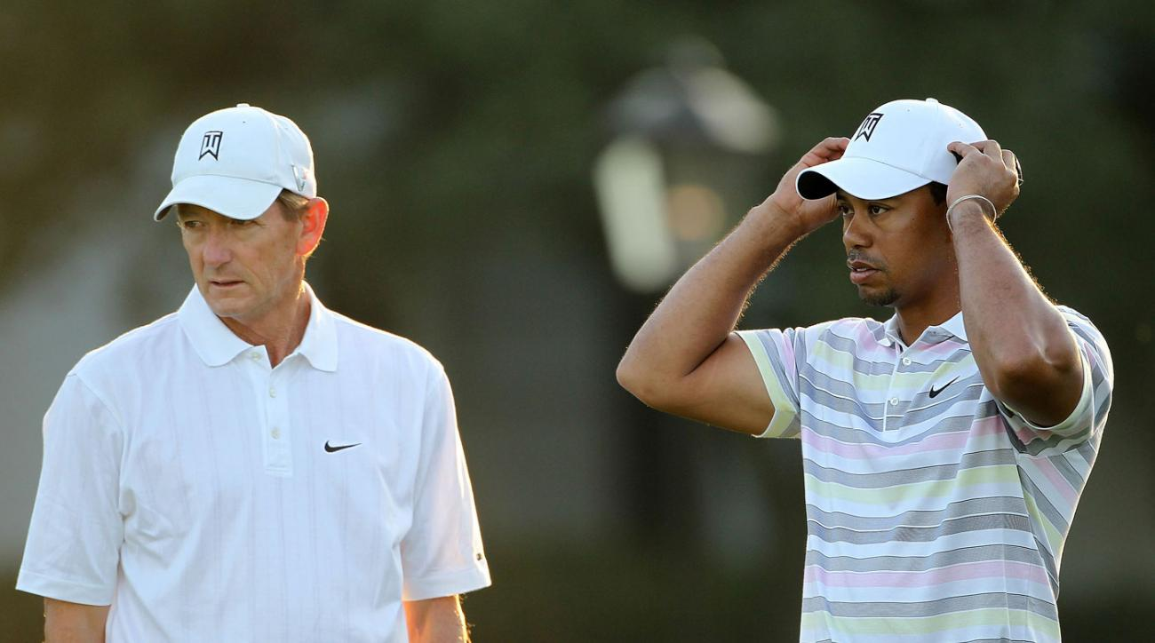 Hank Haney joins Tiger Woods during a practice round at the 2010 Masters.