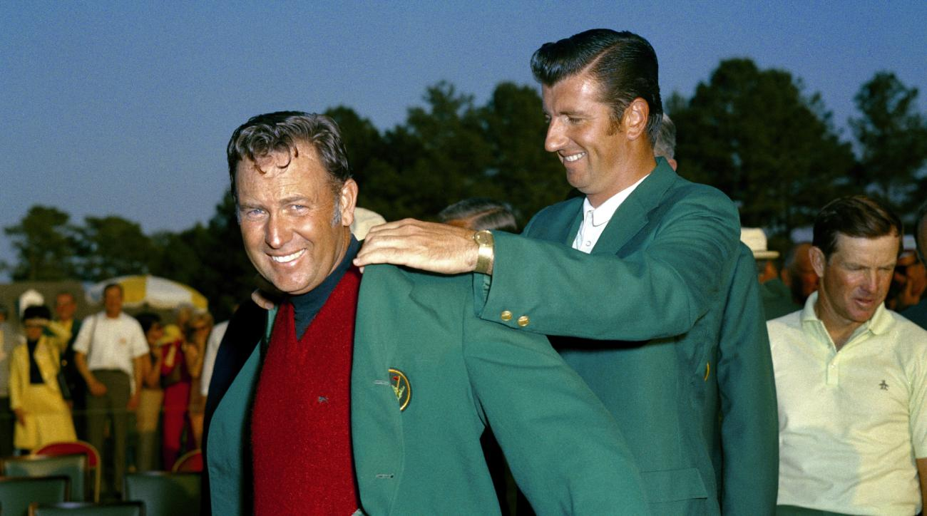 George Archer (right) presents Billy Casper with a green jacket following his victory at the 1970 Masters Tournament.