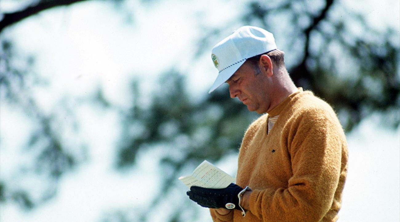 Billy Casper fills out his scorecard during the 1969 Masters. Casper, who won 51 times on the PGA Tour -- including three majors -- died Feb. 7 at age 83.