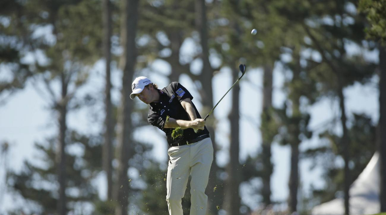 Brandt Snedeker hits from the fairway down to the 10th green of the Spyglass Hill Golf Course during the second round of the AT&T Pebble Beach National Pro-Am golf tournament Friday, Feb. 13, 2015, in Pebble Beach, Calif. (AP Photo/Eric