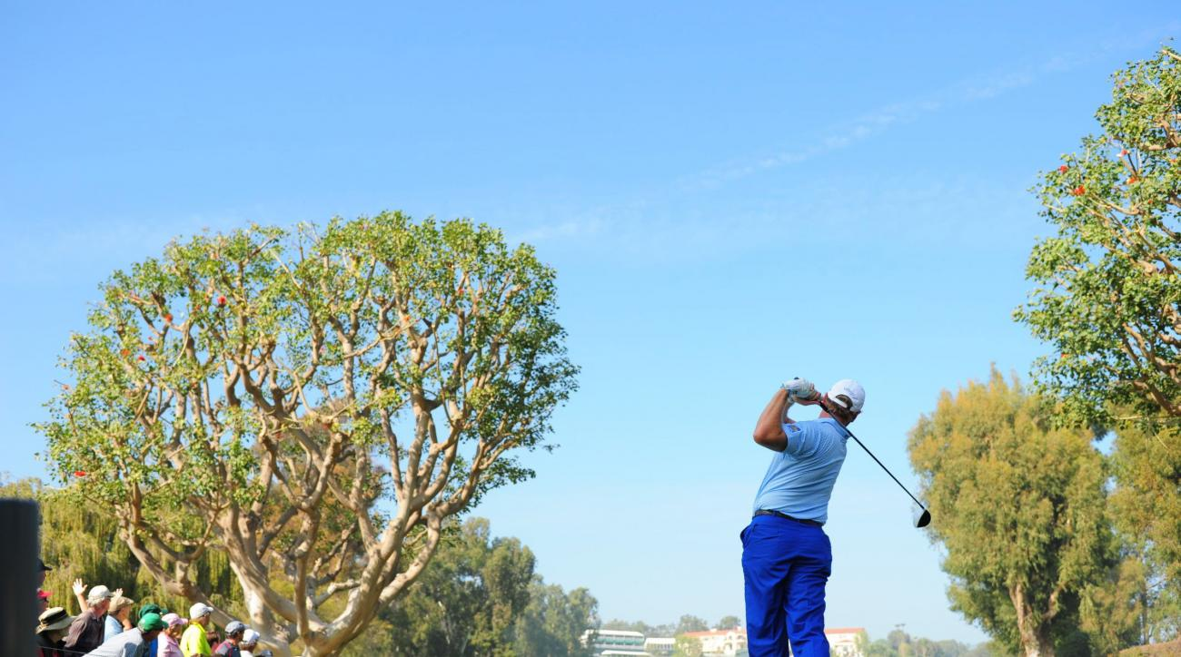 Ernie Els tees off in the first round of the Northern Trust Open at Riviera Country Club in Pacific Palisades, Calif.