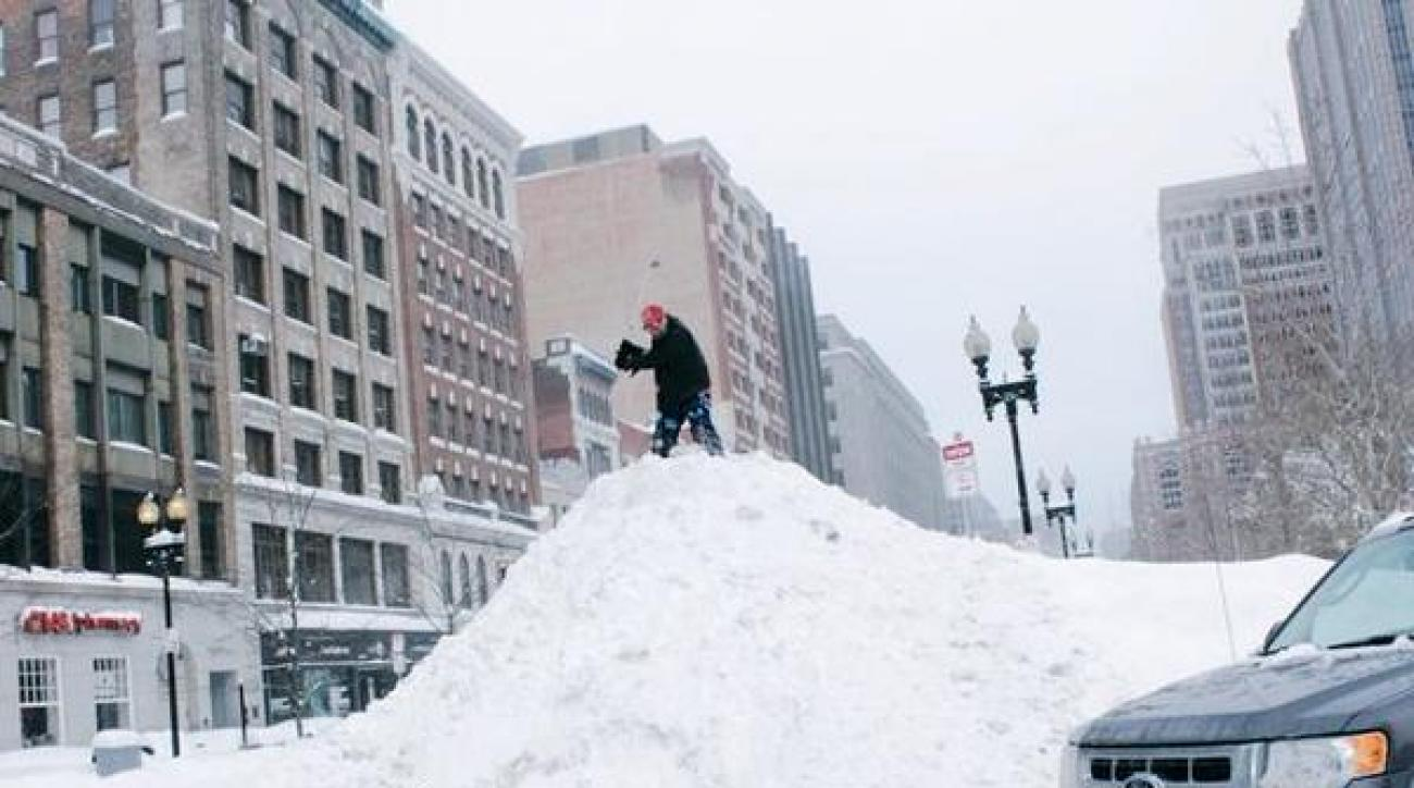 As most in the city hunkered down, images of the Boston Snow Golfer hit the Internet.
