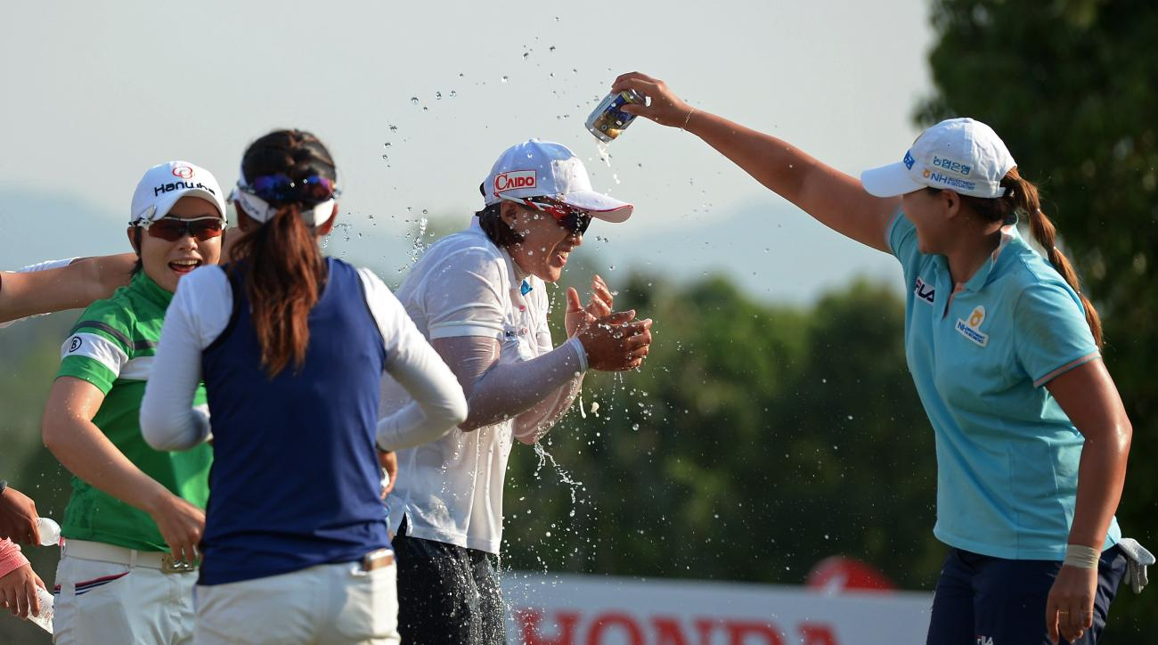 Amy Yang gets doused with beer by her fellow competitors after winning the Honda LPGA Thailand on Sunda.