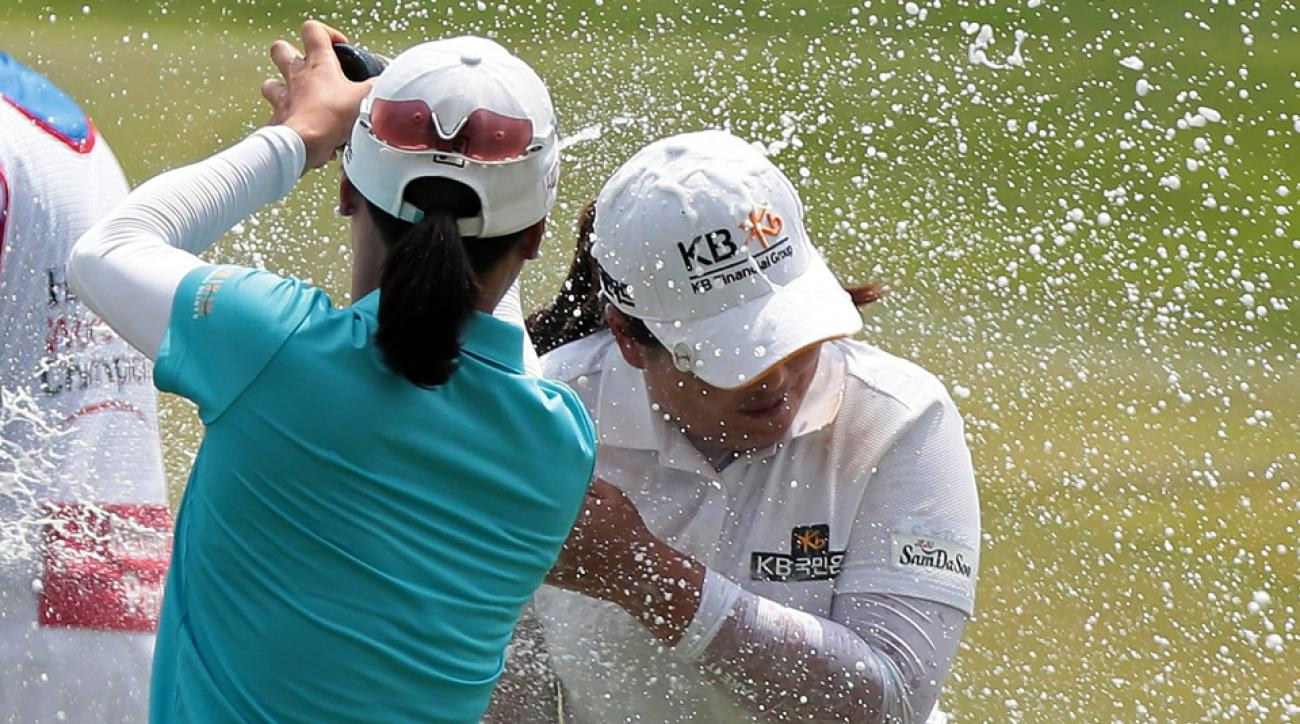 South Korea's Inbee Park (right) celebrates after winning the HSBC Women's Champions at Sentosa Golf Club Sunday in Singapore.