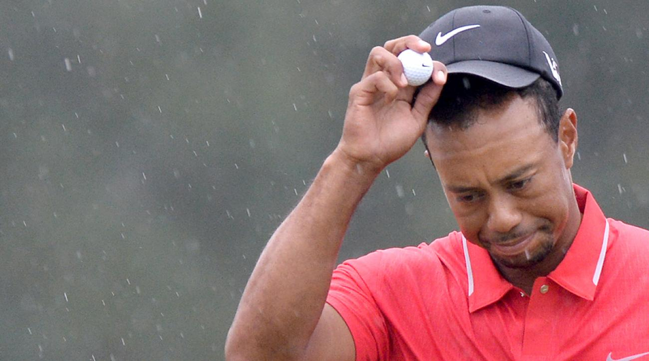 Tiger Woods leaves after putting on the 18th green during the fourth round of the 2013 Masters.