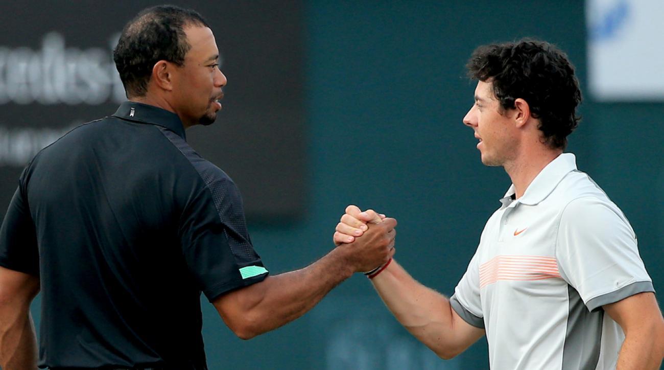 Tiger Woods shakes hands with Rory McIlroy during the second round of the 2014 Omega Dubai Desert Classic on the Majlis Course at the Emirates Golf Club on Jan. 31, 2014, in Dubai, United Arab Emirates.