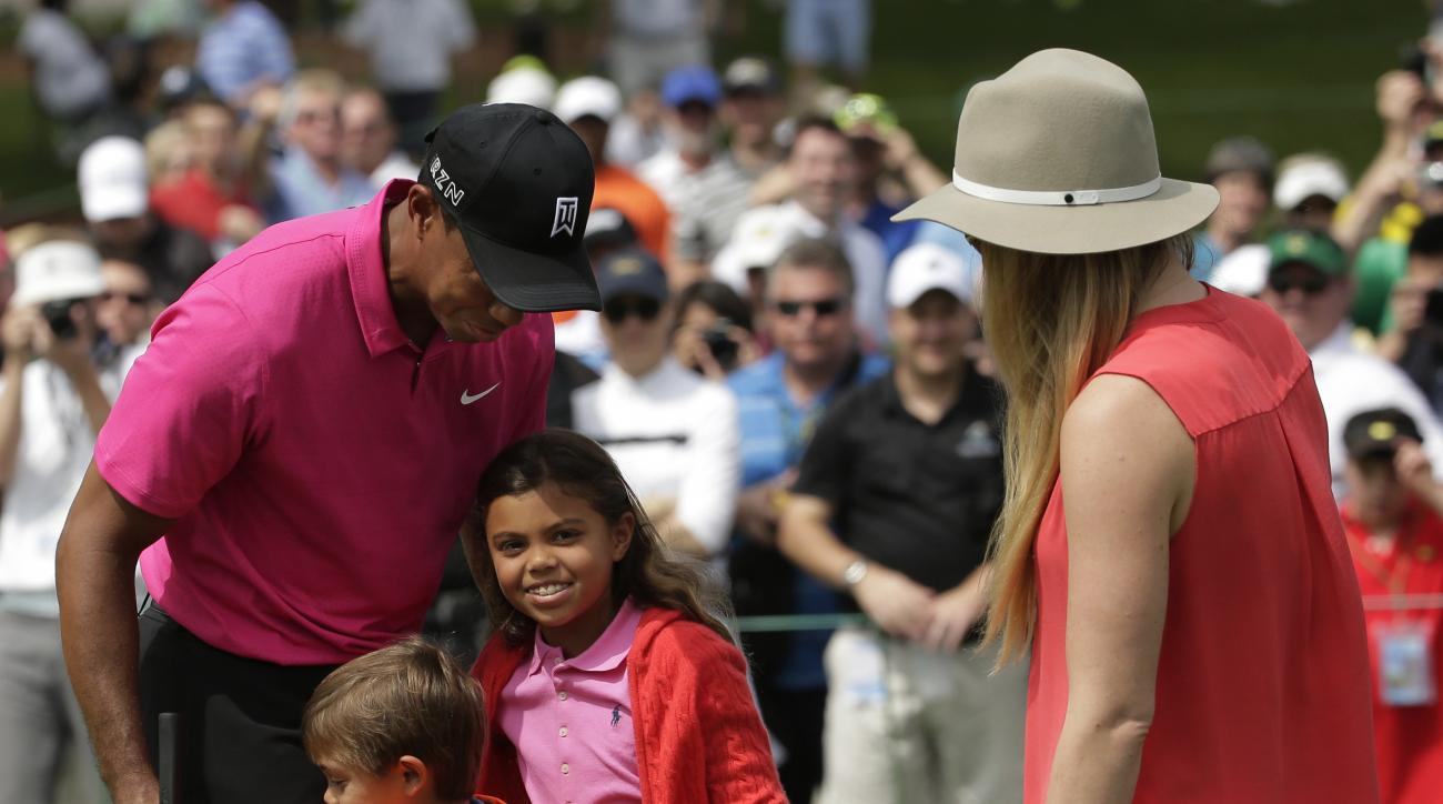 Lindsey Vonn watches as Tiger Woods hugs his children Charlie, left and Sam during a practice round for the Masters on Tuesday.