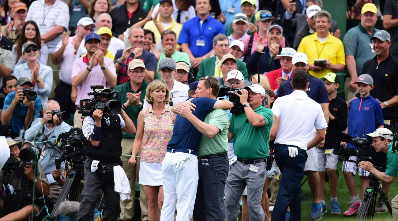 Jordan Spieth hugs his father, Shawn, after winning the 2015 Masters.