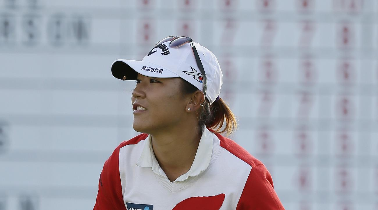 Lydia Ko, of New Zealand, smiles on the 18th green after winning the Swinging Skirts LPGA Classic golf tournament Sunday, April 26, 2015, in Daly City, Calif. Ko won the tournament for the second straight year, defeating Morgan Pressel on the second hole