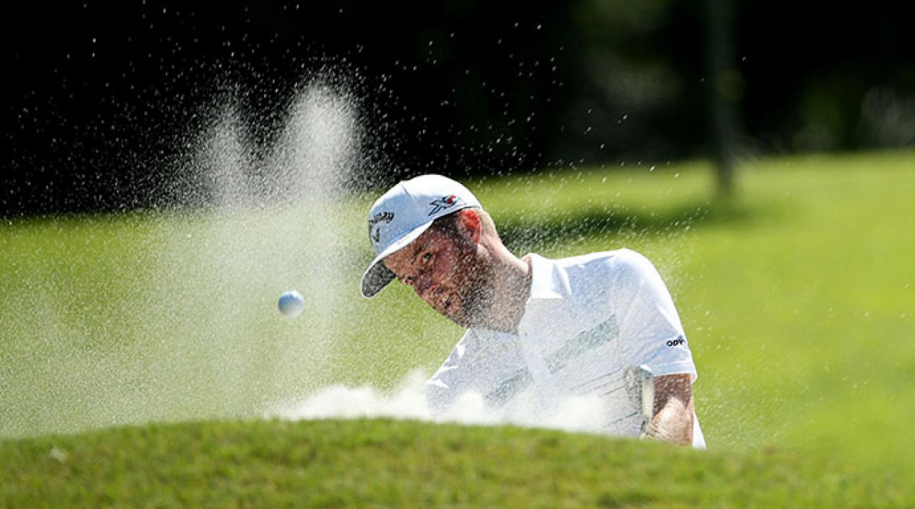 Chris Kirk plays a shot from a bunker on the eighth hole during round three of THE PLAYERS Championship.