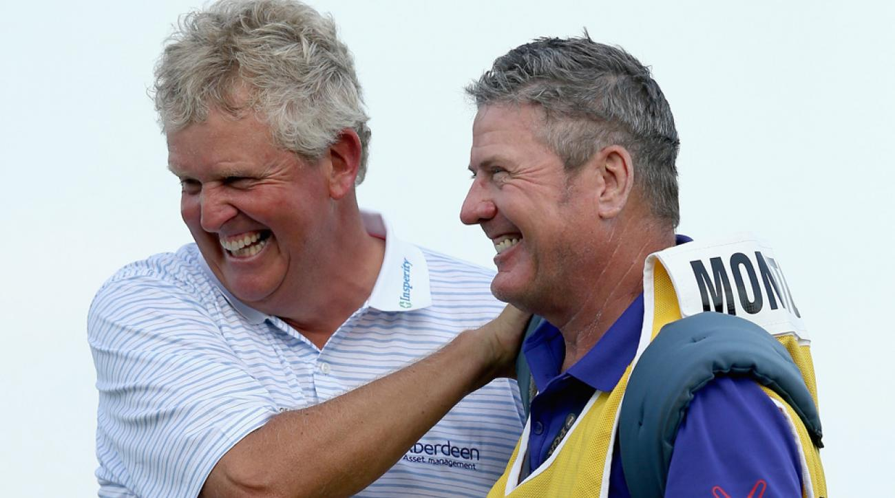 Colin Montgomerie of Scotland and his caddie Alastair McLean celebrate after winning the Senior PGA Championship at the Pete Dye Course at the French Lick Resort on May 24, 2015, in French Lick, Indiana.