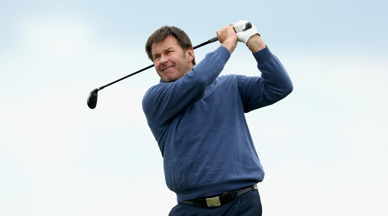 Nick Faldo tees off on the first hole during the first round of the 2015 Senior PGA Championship.