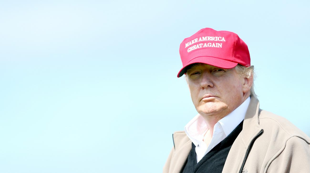 Presidential contender Donald Trump looks on at the 16th green on the first day of the 2015 Women's British Open at Turnberry.