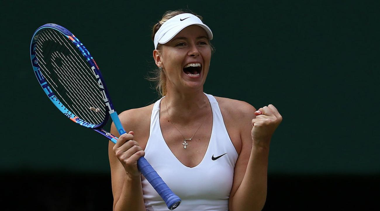 Russia's Maria Sharapova reacts after beating US player Coco Vandeweghe during their women's quarter-finals match on day eight of the 2015 Wimbledon Championships at The All England Tennis Club in Wimbledon, southwest London, on July 7, 2015.