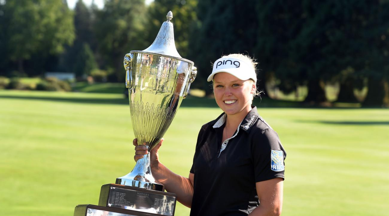 Brooke M. Henderson poses with the trophy after winning the Cambia Portland Classic  in Portland, Ore.