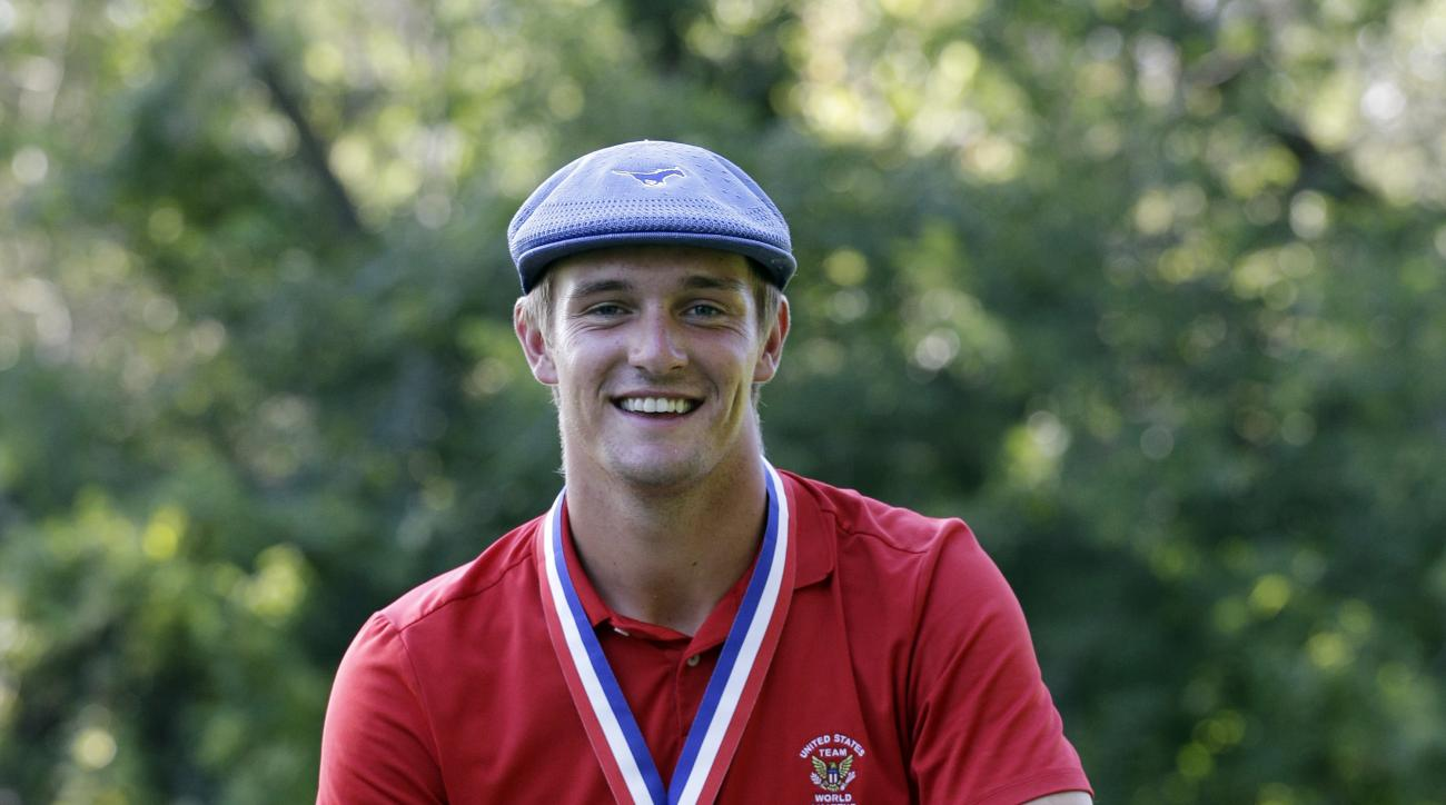 Bryson DeChambeau poses with the trophy after winning the 115th U.S. Amateur Championship golf match at Olympia Fields Country Club on Sunday, Aug. 23, 2015, in Olympia Fields, Ill. (AP Photo/Nam Y.