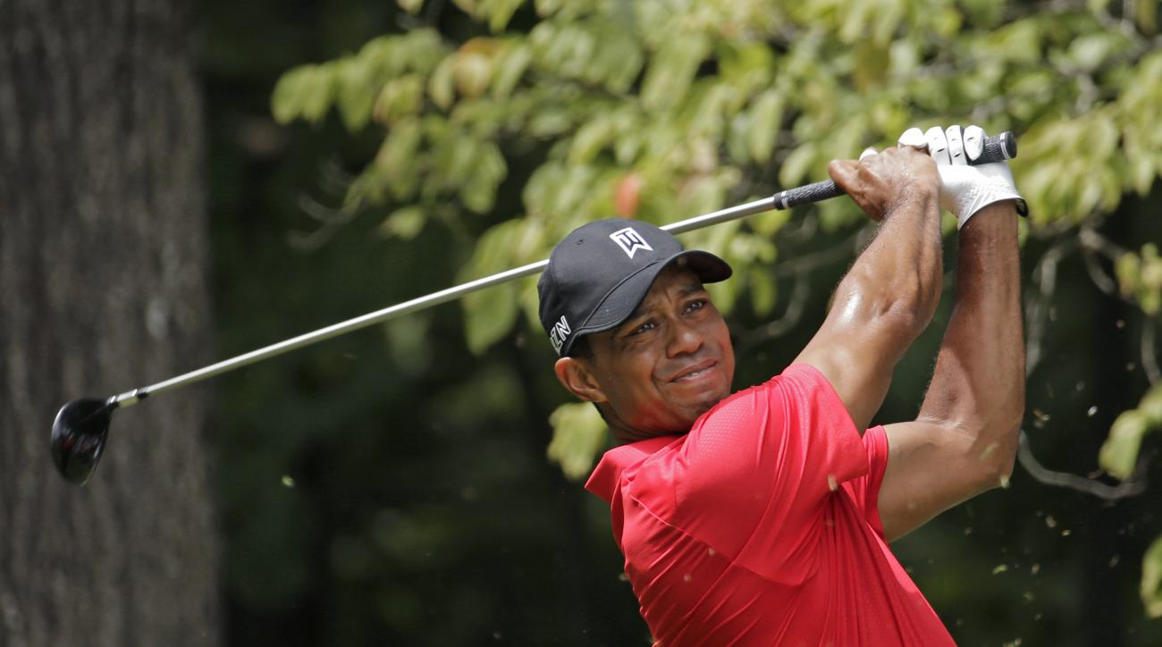 Tiger Woods watches his tee shot on the second hole during the final round of the Wyndham Championship.
