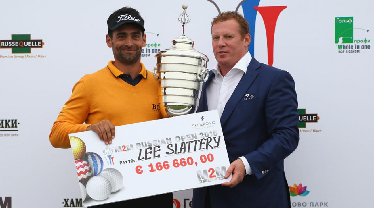 Lee Slattery of England is presented with the winner's trophy and cheque by Andrey Vdovin, Chairman of the Board of Directors M2M Private Bank, after winning the M2M Russian Open at Skolkovo Golf Club on September 6, 2015 in Moscow, Russia.