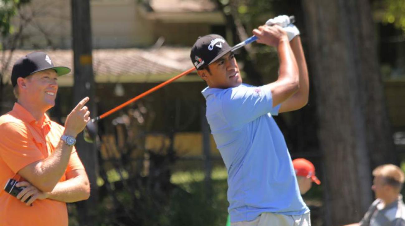 Tony Finau, right, and coach Boyd Summerhays play a scramble at Nibley Park Golf Course in Salt Lake City, Utah, on June 13, 2015.