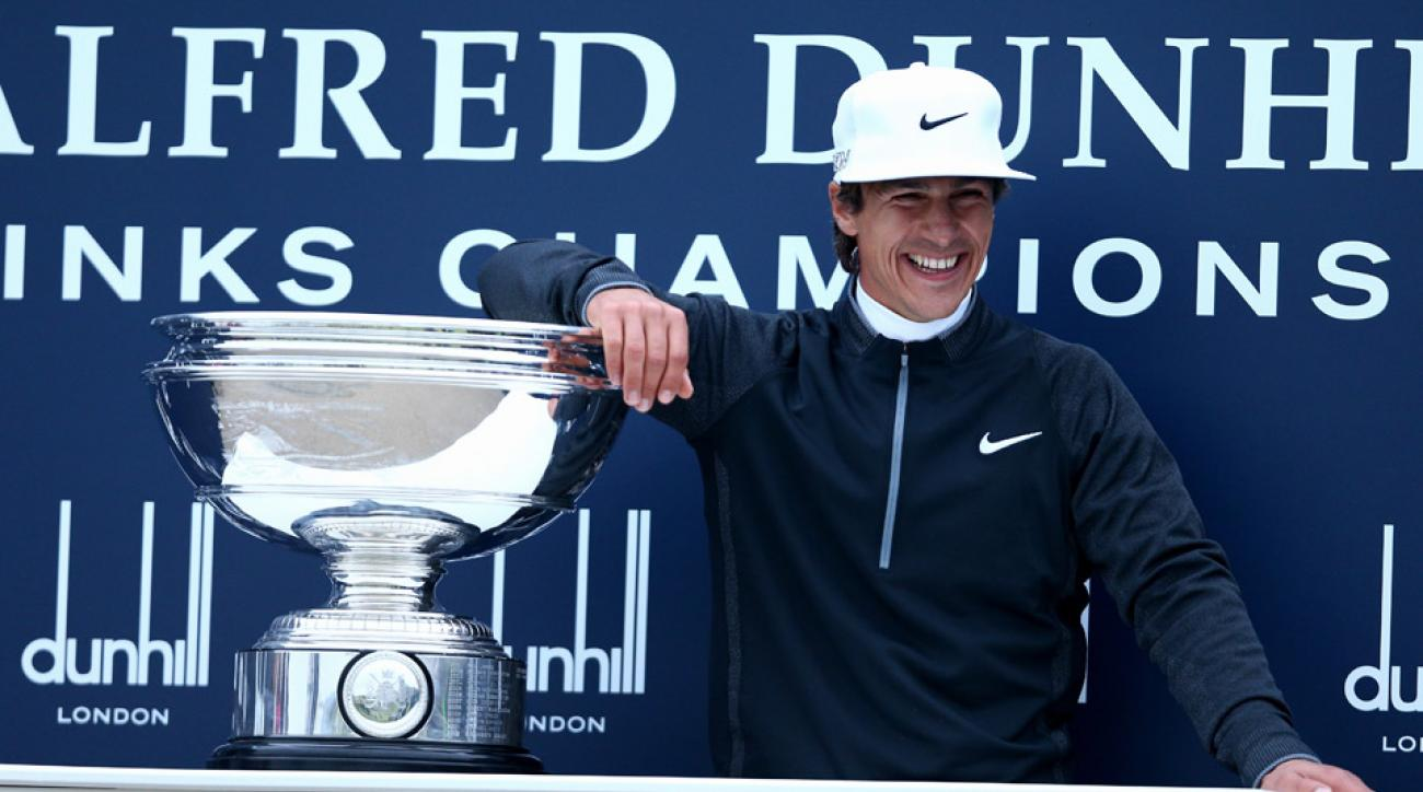 Thorbjorn Olesen smiles for the cameras after winning the Dunhill Links.