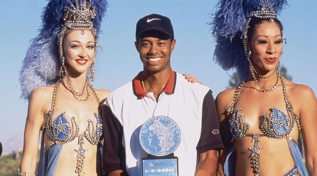 Tiger Woods victorious with trophy at Las Vegas National.