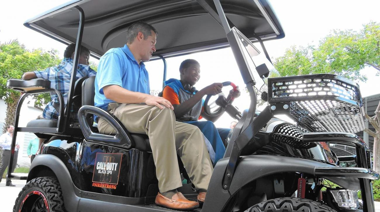 """Danny """"Sire"""" Adams, 14, drives off in a custom golf cart he received Oct. 7, 2015, at a Make-A-Wish Southern Florida event in Boca Raton."""