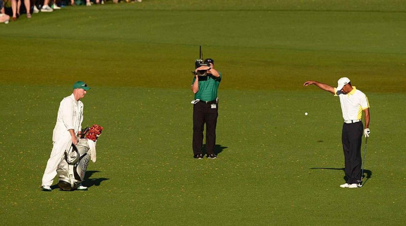 Tiger Woods makes an incorrect drop during the 2013 Masters.