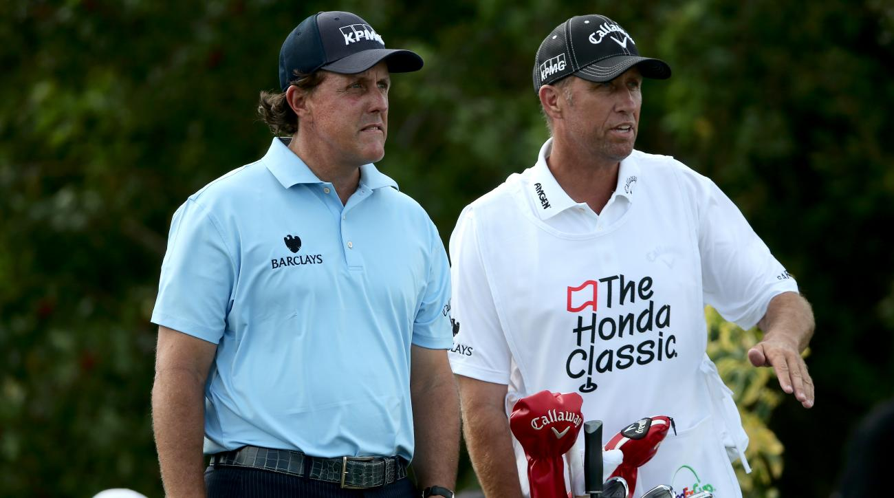 """Phil Mickelson and his caddie Jim """"Bones"""" Mackay in action during the 2015 Honda Classic."""
