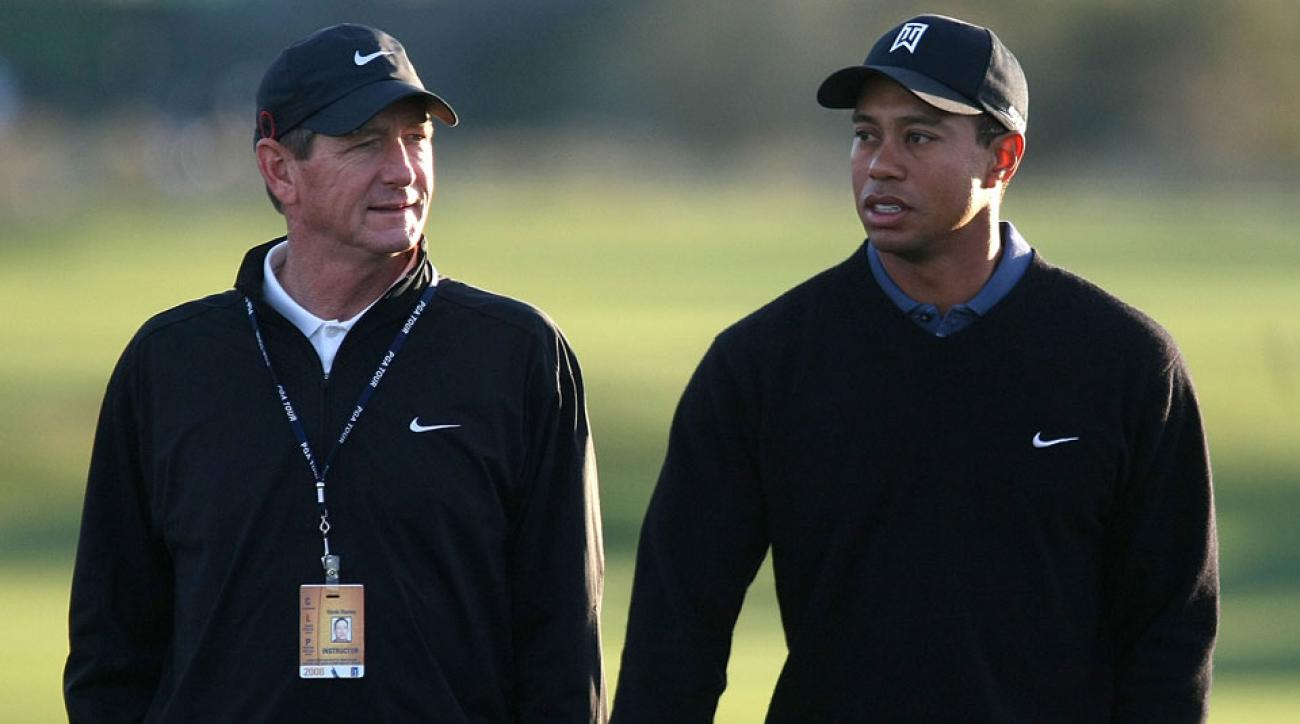 Tiger Woods walks with his former coach Hank Haney during a practice round prior to the start of the Accenture Match Play Championship at The Gallery Golf Club at Dove Mountain on February 19, 2008 in Marana, Arizona.